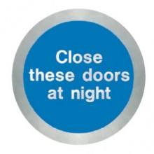 Stainless steel Close these doors at night disc.
